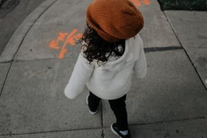 Winter Warmth Drive image of young girl with a beanie walking