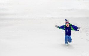Winter Warmth Drive Homepage image boy running in the snow